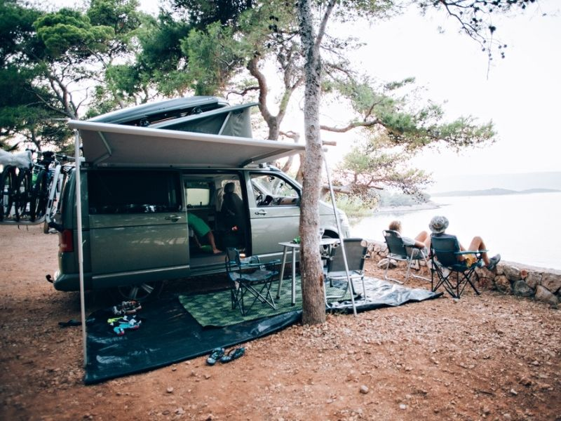 Camping ground cover and awning with camping chairs